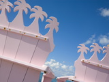 Detail of Wooden Pink Beach Chairs With Backs Carved in the Shape of Palm Trees