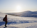 Hiker on Snow Covered Pen Y Fan Mountain  Brecon Beacons National Park  Powys  Wales