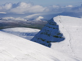 Hikers on Snow Covered Pen Y Fan Mountain  Brecon Beacons National Park  Powys  South Wales