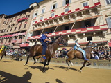 Riders Racing at El Palio Horse Race Festival  Piazza Del Campo  Siena  Tuscany  Italy  Europe