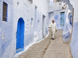 Man in Traditional Moroccan Clothes Walking Down Painted Blue and Steps  Chefchaouen  Morocco
