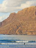 Volcanic Cliffs of the Risco De Famara Rising Over Lanzarote's Finest Beach  Canary Islands