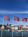Norwegian Flags and Historic Harbour Warehouses  Stavanger  Norway  Scandinavia  Europe