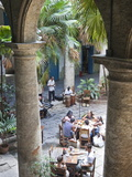 People at Tables and Musicians Playing in Courtyard of Colonial Building Built in 1780  Havana