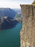 Man Sitting on Preikestolen (Pulpit Rock) Above Fjord  Lysefjord  Norway  Scandinavia  Europe