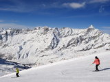 Skiers  Mountain Scenery in Cervinia Ski Resort  Cervinia  Valle D'Aosta  Italian Alps  Italy