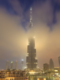 Burj Khalifa Illuminates the Clouds and Surrounding Skyline at Night  Downtown  Dubai  Uae