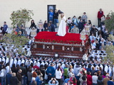 Religious Float Being Carried Through Streets During Semana Santa Celebrations  Malaga  Spain