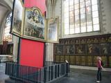Tourist Looking at a Canvas By Rubens  in Onze Lieve Vrouwekathedraal  Antwerp  Flanders  Belgium