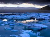 Blue Icebergs Floating on the Jokulsarlon Glacial Lagoon at Sunset  South Iceland  Iceland