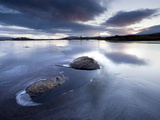 View of Loch Ba' at Dawn  Loch Partly Frozen With Two Large Rocks Protruding From the Ice  Scotland