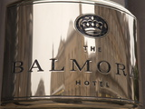 Buildings Reflected in the Balmoral Hotel&#39;s Name Plate  Princes Street  Edinburgh  Scotland  Uk