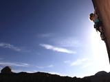 A Rock Climber Tackles An Overhanging Wall on the Cliffs of Indian Creek  South Eastern Utah