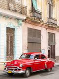 Restrored Red American Car Pakred Outside Faded Colonial Buildings  Havana  Cuba