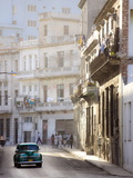 Old American Car Driving Along Quiet Street in Havana Centro  Havana  Cuba