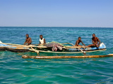 Traditional Rowing Boat in the Turquoise Water of the Indian Ocean  Madagascar  Africa