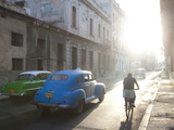 Street Scene Bathed in Early Morning Sunlight Showing Old American Cars and Cyclists  Havana  Cuba