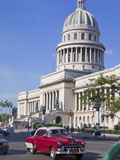 Traditonal Old American Cars Passing the Capitolio Building  Havana  Cuba  West Indies  Caribbean