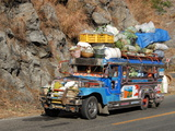 Heavily Loaded Jeepney  a Typical Local Bus  on Kennon Road  Rosario-Baguio  Luzon  Philippines