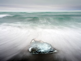 Glacial Ice Washed Ashore By Incoming Tide Onto Beach Near Glacial Lagoon at Jokulsarlon  Iceland