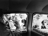 Indian children looking into puppeteer Bil Baird's car  March 1962