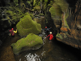 A Guide Leads a Team Through a Passage in Claustral Canyon