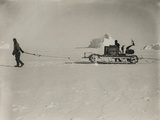 Explorers Guide a Motorized Sledge Hauling Supplies