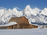 A Historic Barn Below the Grand Teton Range in a Snowy Landscape