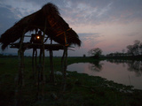 A Kaziranga Park Guard Keeps Watch Through the Night in Baguri