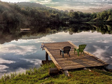 Two Chairs on a Small Dock on a Calm Lake with Cloud Reflections