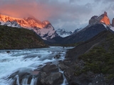 The Peaks of Torres Del Paine Glow in the First Light of Dawn