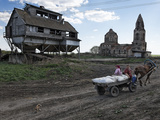 A Horse Cart on a Road Passing An Abandoned Granary and Church