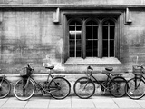 A Row of Bikes Leaning Against an Old School Building in Oxford, England Papier Photo par Keith Barraclough