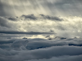 Sunlight Shines Through Clouds on a Sea of Clouds Below