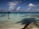 A Woman Wading Near the Pier at the 'Le Maitai Dream' Hotel