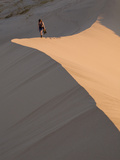 Woman Walking Through Kelso Dunes  Mojave Desert National Reserve  California  United States of Ame