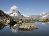 Hiker Resting at Riffelsee and the Matterhorn Behind  Zermatt  Valais  Swiss Alps  Switzerland  Eur