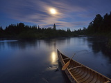Moonlight Bathes a Birchbark Canoe on Maine&#39;s Allagash River