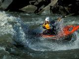 A River Kayak Spins Off a Wave