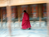 A Tibetan Buddhist Monk Turns Prayer Wheels at Labrang Monastery