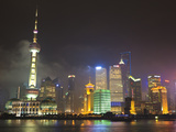 Pudong Skyline at Night across the Huangpu River  Oriental Pearl Tower on Left  Shanghai  China  As