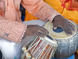 Hindu Musician Playing the Tabla (Drums) with Typical Black Spot Made from a Mixture of Gum  Soot a