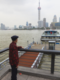 A Man Watching Ferries Crossing the Huangpu River  Shanghai  China  Asia