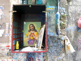 Christian Shrine in Wooden Box on a Street Wall  with Candle  Marigolds and Offerings  Colaba Back