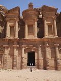 Tourists Being Photographed at the Facade of the Monastery Carved into the Red Rock at Petra  UNESC
