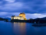 Eilean Donan Castle Floodlit Against the Deep Blue Twilight Sky and Water of Loch Duich  Highlands