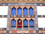 Young Buddhist Monk Looking Out of a Window at Trongsa Dzong  Trongsa  Bhutan  Asia
