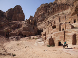 Child Riding a Donkey in Front of Cave Dwellings in Petra  UNESCO World Heritage Site  Jordan  Midd