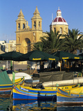 Harbour with Luzzu Fishing Boats and Marsaxlokk Parish Church  Marsaxlokk  Malta  Mediterranean  Eu