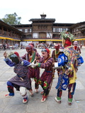 Clowns in Carved Wooden Masks Entertaining Spectators at the Wangdue Phodrang Tsechu  Wangdue Phodr